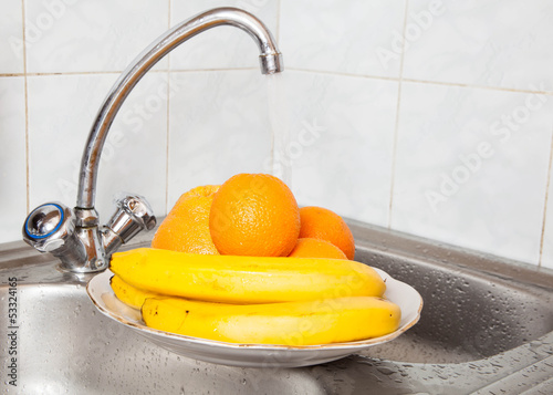 Wash fruits under running water
