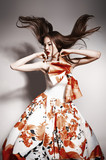 young beautiful asian brunette in gorgeous dress, motion shot