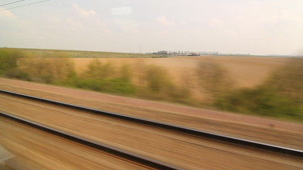 Travelling on a Eurostar train through French countryside.