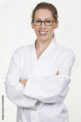 Smiling young female model posing as scientist