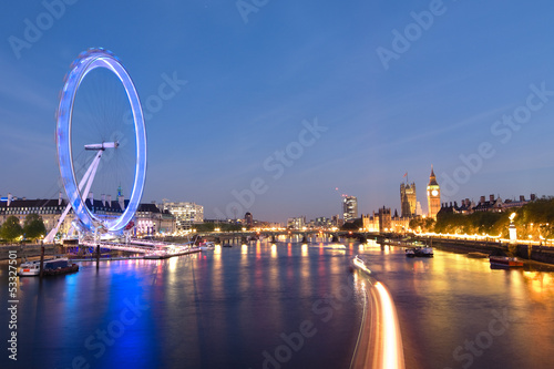 London Eye And Big Ben On The Banks Of Thames River At Twilight
