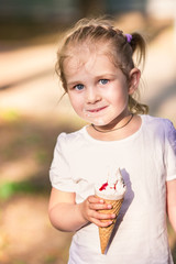 Happy cute child eating ice cream