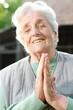 Senior woman holding her hands together