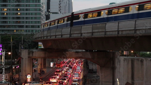 Public train transport, runs through skyscraper, car traffic jam