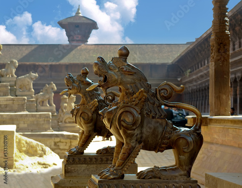 bronze sculptures of lions in front of Ganesh temple