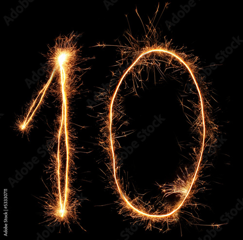 "Number ""ten"" sparklers on black background"