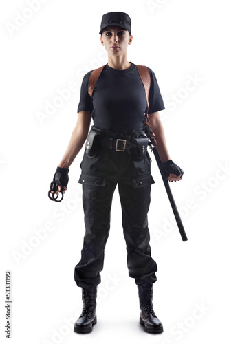 Police officer with handcuffs and baton
