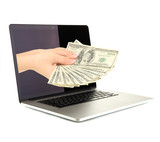 Hand giving money from laptop screen isolated on white