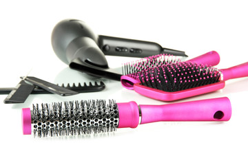 Color comb brushes, hairdryer isolated on white