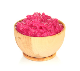 Horseradish sauce with beet in wooden bowl, isolated on white