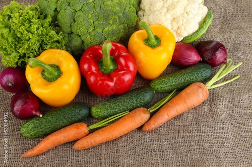 Fresh vegetables on burlap background