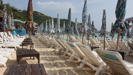 Beach loungers and umbrellas on the beach in Pattaya, Thailand.