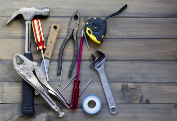 various tools against wooden surface