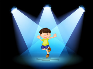 A cute little boy dancing in the stage
