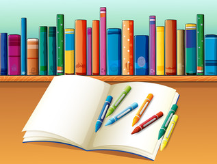 An empty notebook with crayons in front of the shelf with books