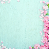 Blue wooden background with pink flowers - 53337537