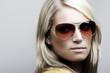 Beautiful Caucasian female model in sunglasses