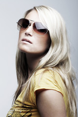Stunning female model wearing sunglasses