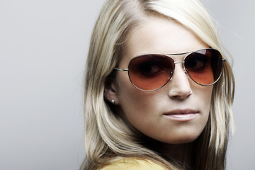 Beautiful Caucasian female model in sunglasses