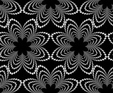Black and white inverted pattern with flower-like figures