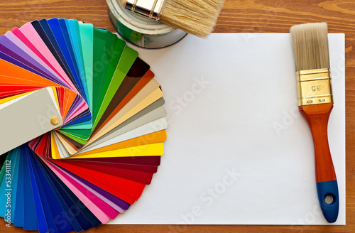 color samples and paint brushes on the wooden table