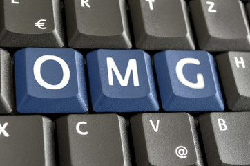 Abbreviation OMG written on computer keyboard