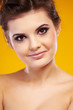 attractive woman portrait on yellow background