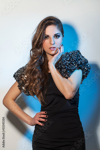 Beautiful young woman with luxury style