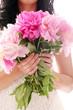 Bouquet of peonies in woman's hands