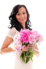 Beautiful woman with bouquet of peonies