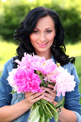 Beautiful woman in casual with peonies