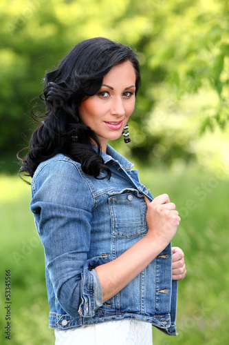 Beautiful brunette woman in casual at the park