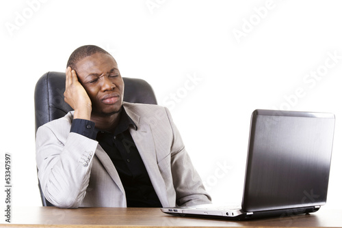 Stressed businessman working on laptop