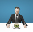 businessman eating money