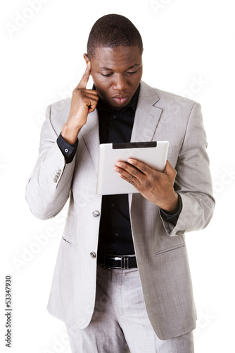 Handsome businessman working on tablet computer.