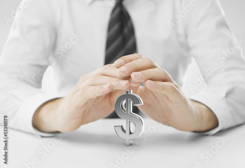 hands covering dollar