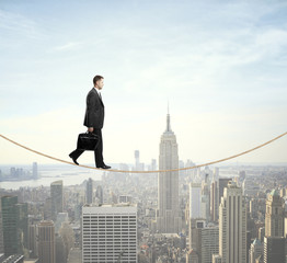 man walking on a rope