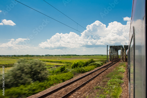 railway goes to horizon  in green and yellow landscape