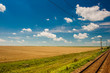 Scenic railroad in rural area  and blue sky with white clouds