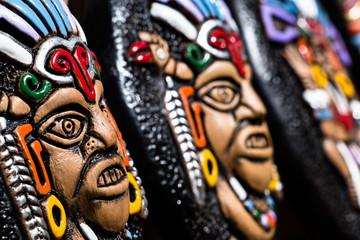 Souvenir masks from argentina, South America.