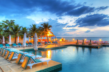Sunset at swimming pool in Thailand