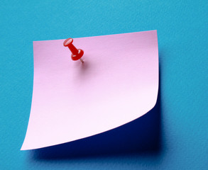 Pink paper note on white background isolated.