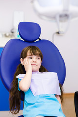 little girl at the dentist complains of toothache