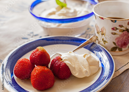 Dessert with strawberry and cream.