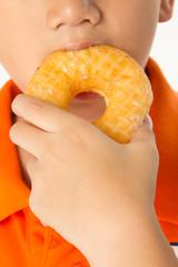 Boy eating a donut