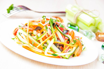 Fresh salad of sliced thin strips of carrot and zucchini as snac