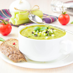 Vegetable green healthy cream soup with avocado, celery, zucchin