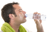 man drinking water and sweating