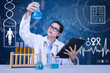 Beautiful scientist analysing solution on blue background
