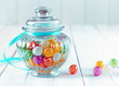 Colourful candy in a decorative jar